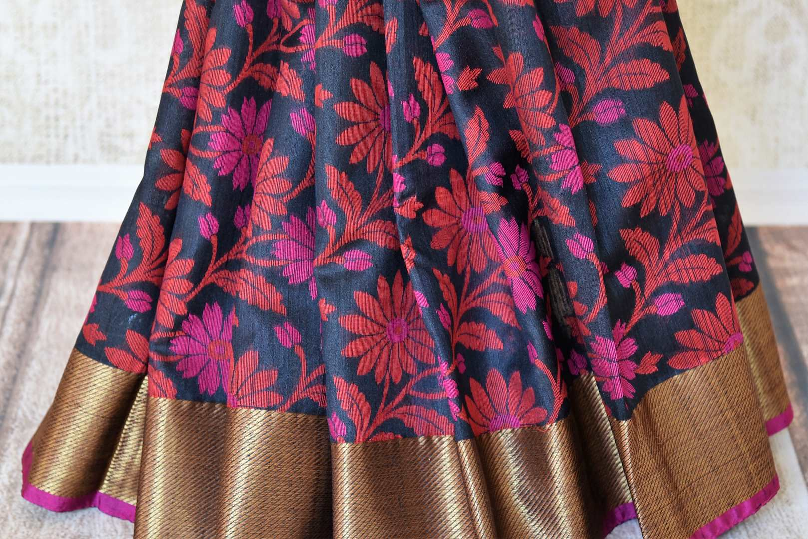 Buy black floral tussar Banarasi sari with zari border online in USA. Adorn yourself in glorious Indian clothing from Pure Elegance Indian clothing store in USA. We have an exclusive range of Indian designer sarees, traditional handloom saris, Banarasi sarees to make your Indian look absolutely captivating.-pleats