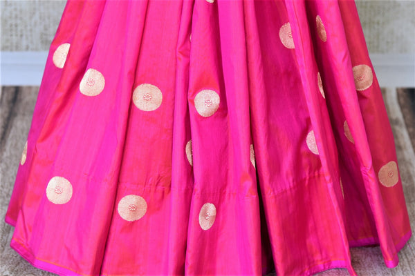 Buy bright pink Banarasi silk sari online in USA with zari buta. Keep it elegant in woven Indian Banarasi silk sarees available at Pure Elegance exclusive Indian fashion store in USA or browse through our website and shop online.-pleats