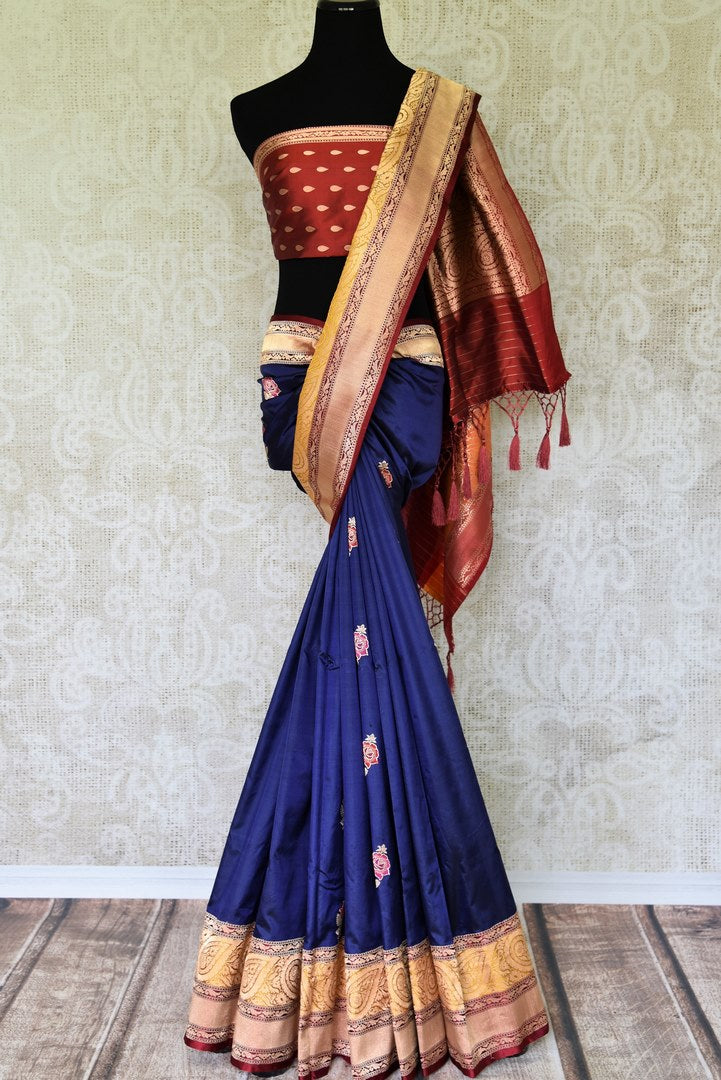 Exude elegance in our royal blue banarsi silk authentic sare. The subtle contrast of cream zari border complemented with the deep rich red buta work blouse is indeed a spectacular sight. Style this to weddings and parties. Shop designer silk sari, chiffon saree, linen sari online or visit Pure Elegance Store, USA. -full view