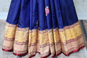 Exude elegance in our royal blue banarsi silk authentic sare. The subtle contrast of cream zari border complemented with the deep rich red buta work blouse is indeed a spectacular sight. Style this to weddings and parties. Shop designer silk sari, chiffon saree, linen sari online or visit Pure Elegance Store, USA. -pleats
