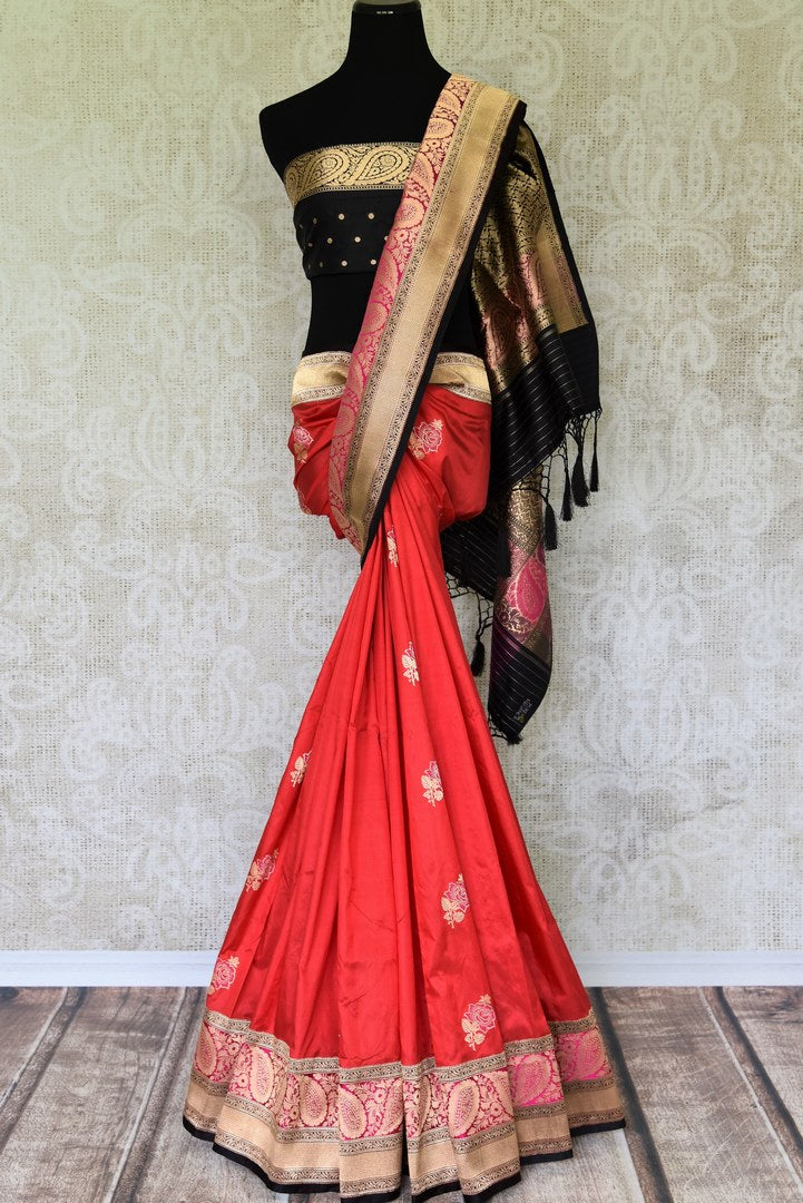 The charming pink banarsi silk authentic saree is your knight in shining armour. The woven floral buta work and rich zari border adds a touch of glamour. Style this sari with a contrast black buta work designer blouse. Shop designer silk saree, georgette sari, chiffon sari online or visit Pure Elegance store, USA. -full view