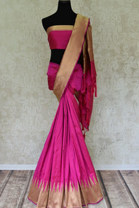 Buy bright pink Banarasi silk sari online in USA with temple border. Get your traditional style right with a range of beautiful Indian designer sarees from Pure Elegance clothing store in USA. Choose from a range of exquisite Banarasi sarees, silk sarees, wedding sarees also available at our online store.-full view