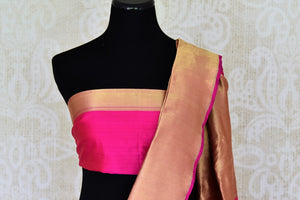 Buy bright pink Banarasi silk sari online in USA with temple border. Get your traditional style right with a range of beautiful Indian designer sarees from Pure Elegance clothing store in USA. Choose from a range of exquisite Banarasi sarees, silk sarees, wedding sarees also available at our online store.-blouse pallu