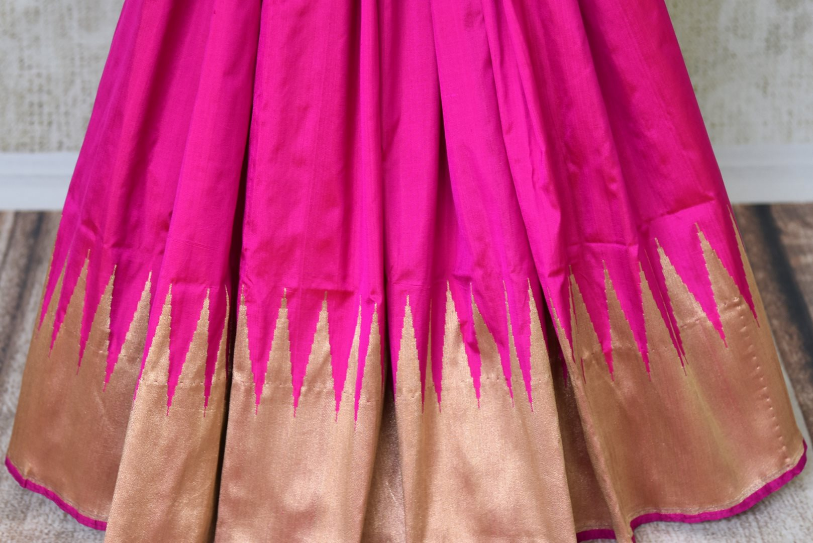 Buy bright pink Banarasi silk sari online in USA with temple border. Get your traditional style right with a range of beautiful Indian designer sarees from Pure Elegance clothing store in USA. Choose from a range of exquisite Banarasi sarees, silk sarees, wedding sarees also available at our online store.-pleats
