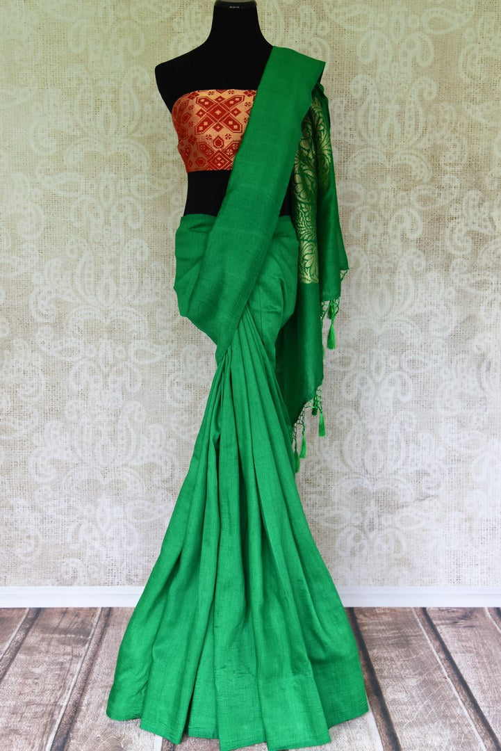 Satiate your saree appetite in this green muga silk drapery with a gorgeous silver zari work designed on the pallu. Style this piece with a statement red zari designer blouse to add a pop of color. Shop handcrafted silk saris, linen saree, chiffon saree online or visit Pure Elegance store, USA.-full view