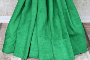 Satiate your saree appetite in this green muga silk drapery with a gorgeous silver zari work designed on the pallu. Style this piece with a statement red zari designer blouse to add a pop of color. Shop handcrafted silk saris, linen saree, chiffon saree online or visit Pure Elegance store, USA.-pleats