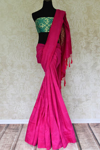 Exude an essence of feminity as you drape this bright pink muga silk saree. Style it with a gorgeous mint green zardosi embroidered blouse to turn heads. The intricate detailing on the pallu looks incredible. Shop such designer silk sarees, georgette sari, embroidered sari online or visit Pure Elegance store, USA.-full view