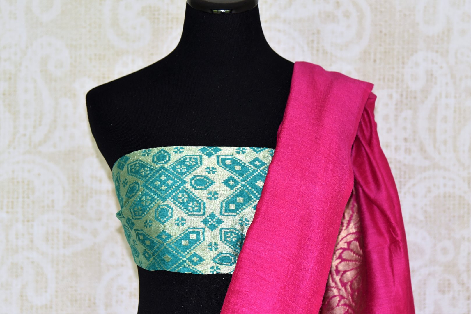 Exude an essence of feminity as you drape this bright pink muga silk saree. Style it with a gorgeous mint green zardosi embroidered blouse to turn heads. The intricate detailing on the pallu looks incredible. Shop such designer silk sarees, georgette sari, embroidered sari online or visit Pure Elegance store, USA.-blouse pallu