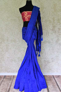 Enchant the folks in this royal blue muga silk saree. It comes with gorgeous silver zari detailing on the pallu. Style this stunning sari with a contrasting red zari designer blouse. Shop handcrafted silk sarees, linen sari, georgette sari online or visit Pure Elegance store, USA.-full view