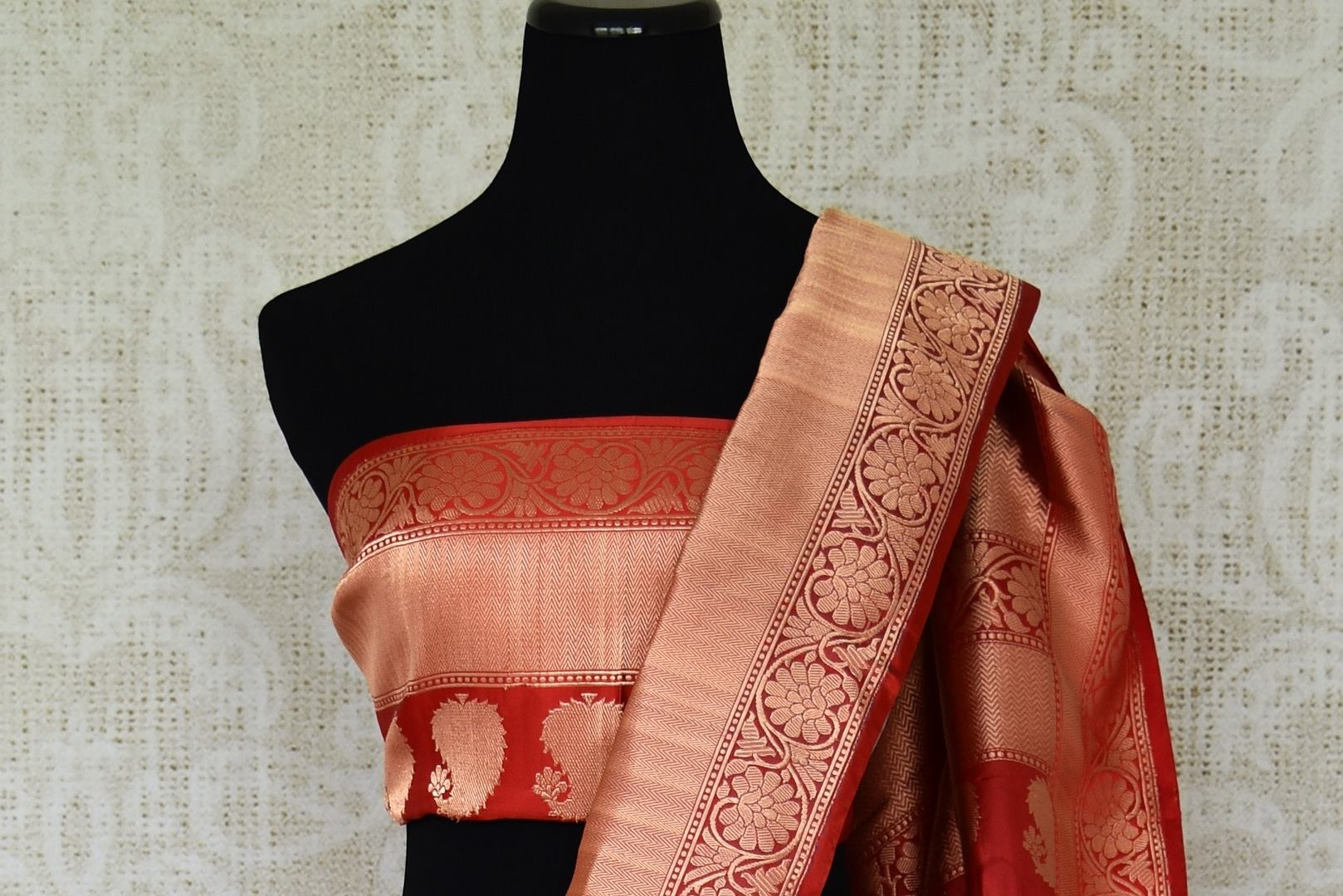 Strut in style in this grey banarsi silk saree with a stunning red zari border. It features an exquisite check pattern and glorious shine on the drape. Style this gorgeous sari with a contrast red zari detailed blouse. Shop kanjeevaram silk sari, georgette saree, chiffon sari online or visit Pure Elegance store, USA.-blouse pallu