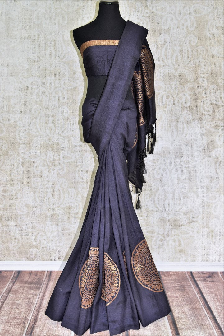 Steal the spotlight in this exclusively tailored black muga silk saree. The dull gold designs on the pleats and pallu enhance its beauty! Style this gorgeous sari with a stunning black blouse. Shop handcrafted silk sarees, embroidered sari, printed sari online or visit Pure Elegance store, USA.-full view