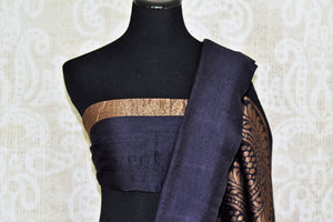 Steal the spotlight in this exclusively tailored black muga silk saree. The dull gold designs on the pleats and pallu enhance its beauty! Style this gorgeous sari with a stunning black blouse. Shop handcrafted silk sarees, embroidered sari, printed sari online or visit Pure Elegance store, USA.-blouse pallu