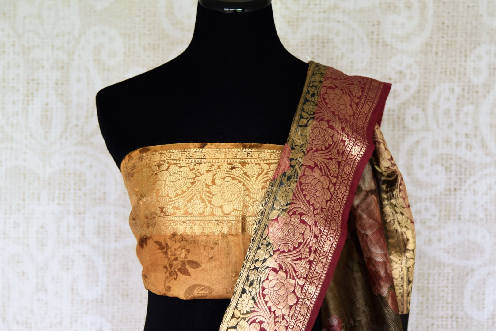 Exude sass in this exquisitely designed brown banarsi silk saree with a blend of floral pattern. The sheer ombre designer sari comes with a zari border and is styled beautifully with a gold zari blouse to enhance its elegance. Shop designer silk sari, ikkat sarees, linen sari online or visit Pure Elegance store, USA.-blouse pallu