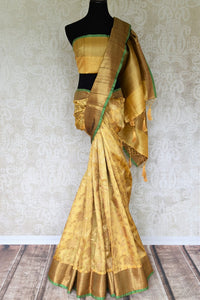 Drape the yellow tussar banarsi silk saree that features a handwoven border. The subtle sophistication reflected through the self-embossed floral pattern and a plain yellow blouse. Style this ensemble to soirees and events. Shop designer silk saree, chiffon sari, ikkat sari online or visit Pure Elegance store, USA. -full view