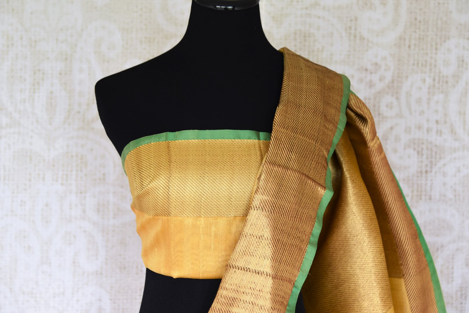Drape the yellow tussar banarsi silk saree that features a handwoven border. The subtle sophistication reflected through the self-embossed floral pattern and a plain yellow blouse. Style this ensemble to soirees and events. Shop designer silk saree, chiffon sari, ikkat sari online or visit Pure Elegance store, USA. -blouse pallu