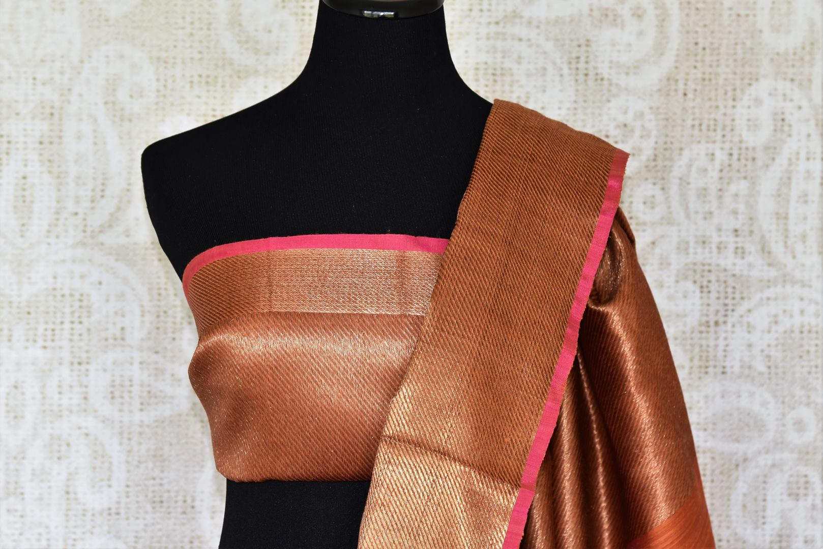 Exude sheer elegance in this gorgeous brown matka banarsi silk saree. It comes with a stunning zari weave border gracing the sari. Style it with a statement zari gold weave blouse to ooze the oomph. Shop handcrafted designer silk saris, printed saree, embroidery sari online or visit Pure Elegance store, USA.-blouse pallu