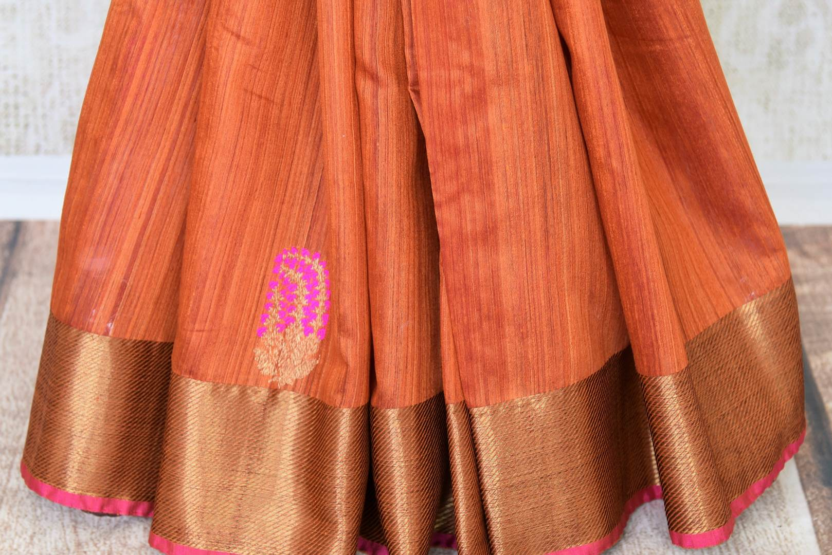 Exude sheer elegance in this gorgeous brown matka banarsi silk saree. It comes with a stunning zari weave border gracing the sari. Style it with a statement zari gold weave blouse to ooze the oomph. Shop handcrafted designer silk saris, printed saree, embroidery sari online or visit Pure Elegance store, USA.-pleats