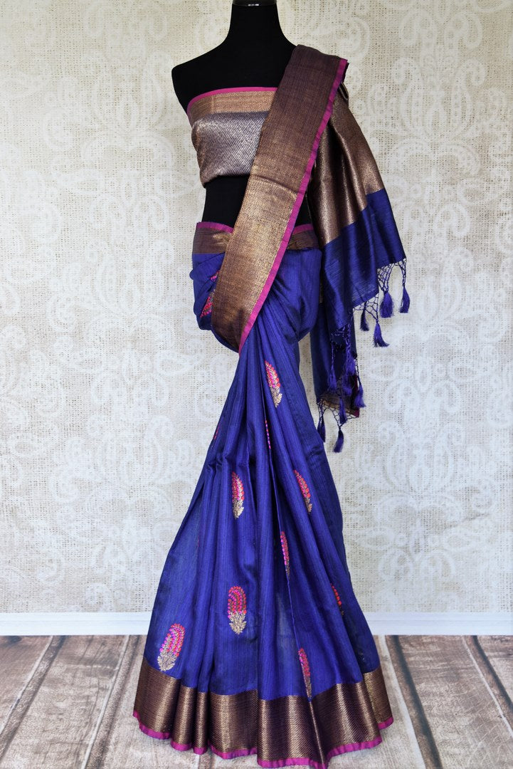 Indulge in this scintillating royal blue matka banarsi silk saree. It comes with a gorgeous zari weave border and contrasting blue zari blouse to create a stunning ensemble. The intricately woven butas all over the sari looks beautiful. Shop designer silk sari, printed saree online or visit Pure Elegance store, USA.-full view