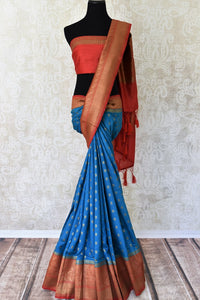 Buy blue tussar Benarasi saree online in USA with red zari border and zari buta. Make an elegant ethnic fashion statement at parties, weddings and special occasions with a splendid collection of Indian designer sarees, Benarasi saris, wedding sarees from Pure Elegance Indian clothing store in USA or shop online.-full view