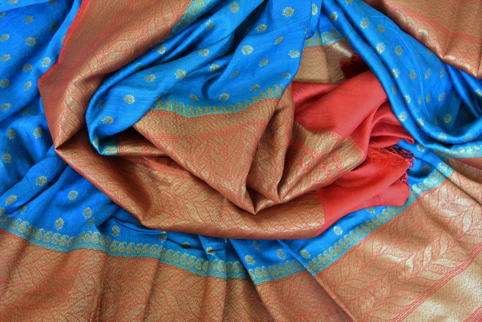 Buy blue tussar Benarasi saree online in USA with red zari border and zari buta. Make an elegant ethnic fashion statement at parties, weddings and special occasions with a splendid collection of Indian designer sarees, Benarasi saris, wedding sarees from Pure Elegance Indian clothing store in USA or shop online.-details
