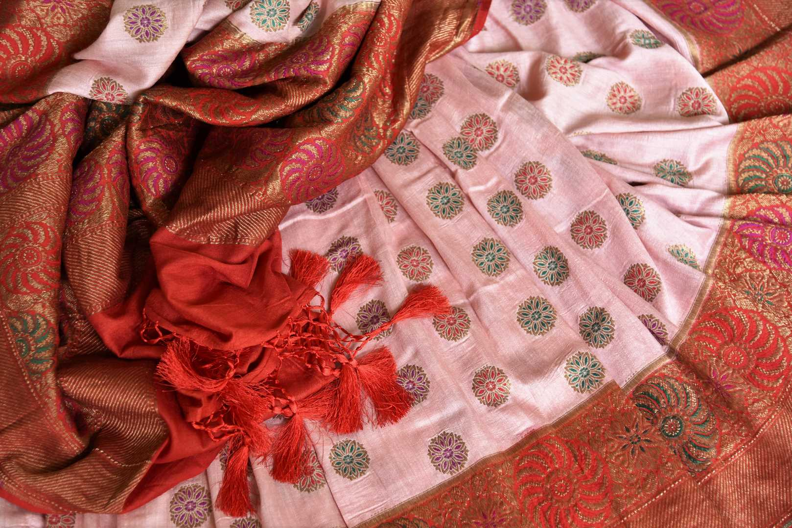 Grace with finesse in this gorgeous pink muga banarsi silk saree. Woven with pretty motifs all-over, it features a rich red zari border and complemented well with a contrasting red zari blouse to enrich the ensemble. Shop designer silk sarees, georgette sari, organza sari online or visit Pure Elegance store, USA.-details