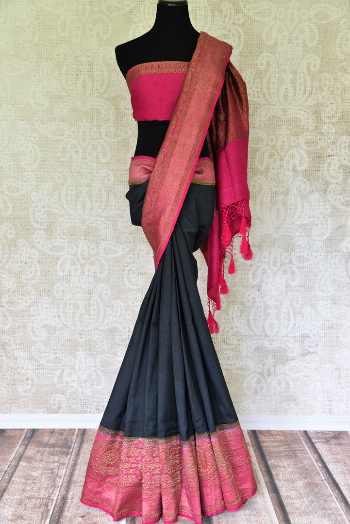 Strut the town in this glorious black muga silk saree curated with finesse. Style this sari with a gorgeous contrasting pink plain blouse that complements the pink zari border and heavily woven pallu. Shop banarsi silk sarees, embroidered sari, georgette sari online or visit Pure Elegance store, USA.-full view