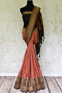 Strike a lasting impression in this suave brown muga banarsi silk sari. Enhance the beauty with a plain black zari border blouse and zari gold weave border. The heavily woven pallu further amps up the grace of this sari. Shop designer silk sari, georgette sari, kalamkari saree online or visit Pure Elegance store, USA.-full view