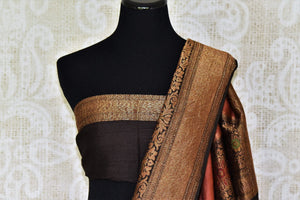 Strike a lasting impression in this suave brown muga banarsi silk sari. Enhance the beauty with a plain black zari border blouse and zari gold weave border. The heavily woven pallu further amps up the grace of this sari. Shop designer silk sari, georgette sari, kalamkari saree online or visit Pure Elegance store, USA.-blouse pallu