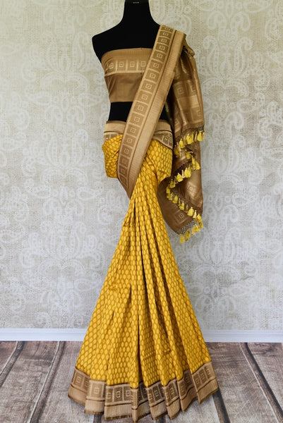 Fall in love with the intricately woven yellow banarsi silk authentic saree. It comes with a gorgeous brown woven border and pallu. Style this saree with a brown woven blouse to steal the spotlight. Shop designer silk sarees, linen sari, ikkat saree online or visit Pure Elegance store, USA. -full view