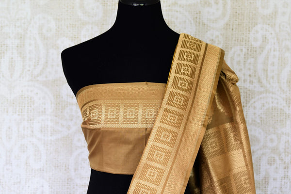 Fall in love with the intricately woven yellow banarsi silk authentic saree. It comes with a gorgeous brown woven border and pallu. Style this saree with a brown woven blouse to steal the spotlight. Shop designer silk sarees, linen sari, ikkat saree online or visit Pure Elegance store, USA. -blouse pallu