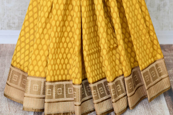 Fall in love with the intricately woven yellow banarsi silk authentic saree. It comes with a gorgeous brown woven border and pallu. Style this saree with a brown woven blouse to steal the spotlight. Shop designer silk sarees, linen sari, ikkat saree online or visit Pure Elegance store, USA. -pleats