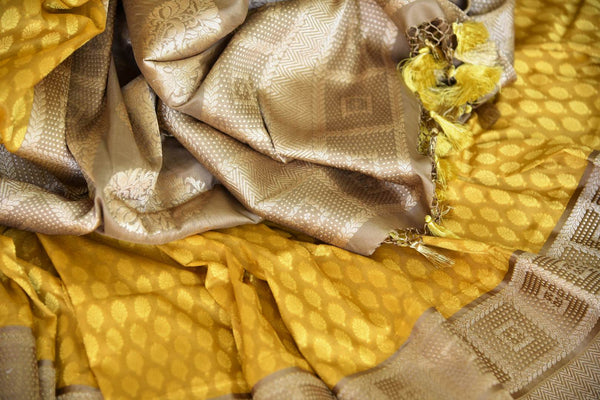 Fall in love with the intricately woven yellow banarsi silk authentic saree. It comes with a gorgeous brown woven border and pallu. Style this saree with a brown woven blouse to steal the spotlight. Shop designer silk sarees, linen sari, ikkat saree online or visit Pure Elegance store, USA. -details