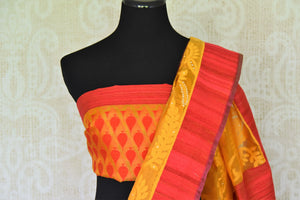 Feel like a diva in this modern fusion orange kora organza saree. This designer sari features elaborate design all-over complemented with a stunning red border. Style it with a designer orange and red buta work blouse. Shop handloom sarees, banarsi silk sari, georgette saree online or visit Pure Elegance store, USA. -blouse pallu