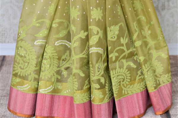Buy light green organza Banarasi saree online in USA with pink border. Add beautiful Indian Banarasi sarees from Pure Elegance Indian clothing store in USA to your ethnic wardrobe now. You can also shop online at the comfort of your home.-pleats