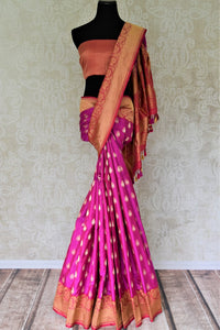 Buy beautiful magenta Banarasi silk sari online in USA with zari border. Add beautiful Indian wedding sarees to your ethnic wardrobe from Pure Elegance Indian clothing store in USA. You can also shop online at the comfort of your home.-full view