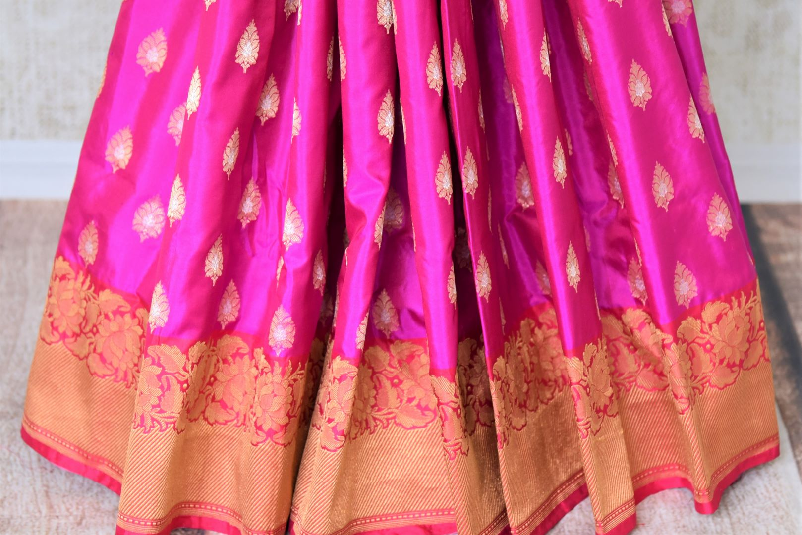 Buy beautiful magenta Banarasi silk sari online in USA with zari border. Add beautiful Indian wedding sarees to your ethnic wardrobe from Pure Elegance Indian clothing store in USA. You can also shop online at the comfort of your home.-pleats