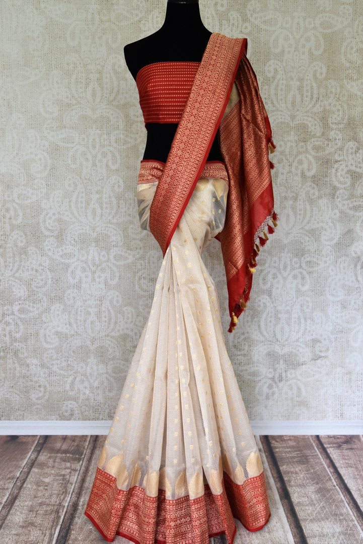 Off-white organza silk saree buy online in USA with zari border and buta. Adorn your style with a range of exquisite handloom sarees from Pure Elegance Indian clothing store in USA. We have an exquisite range of Indian designer sarees, silk sarees, Banarasi sarees and many other varieties also available at our online store.-full view