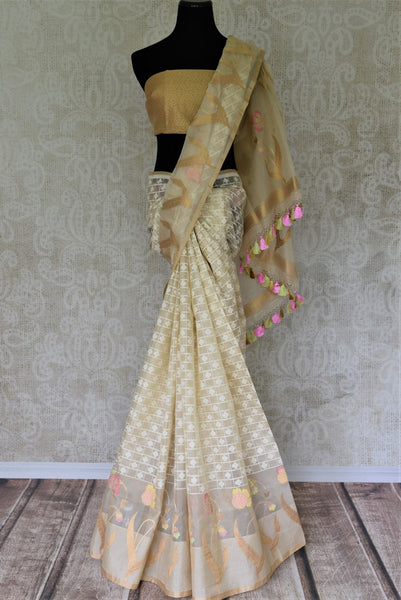 Buy cream organza Banarasi saree online in USA with check design. Give your Indian look an extra style edge with beautiful Indian designer sarees available at Pure Elegance Indian clothing store in USA or shop online.-full view