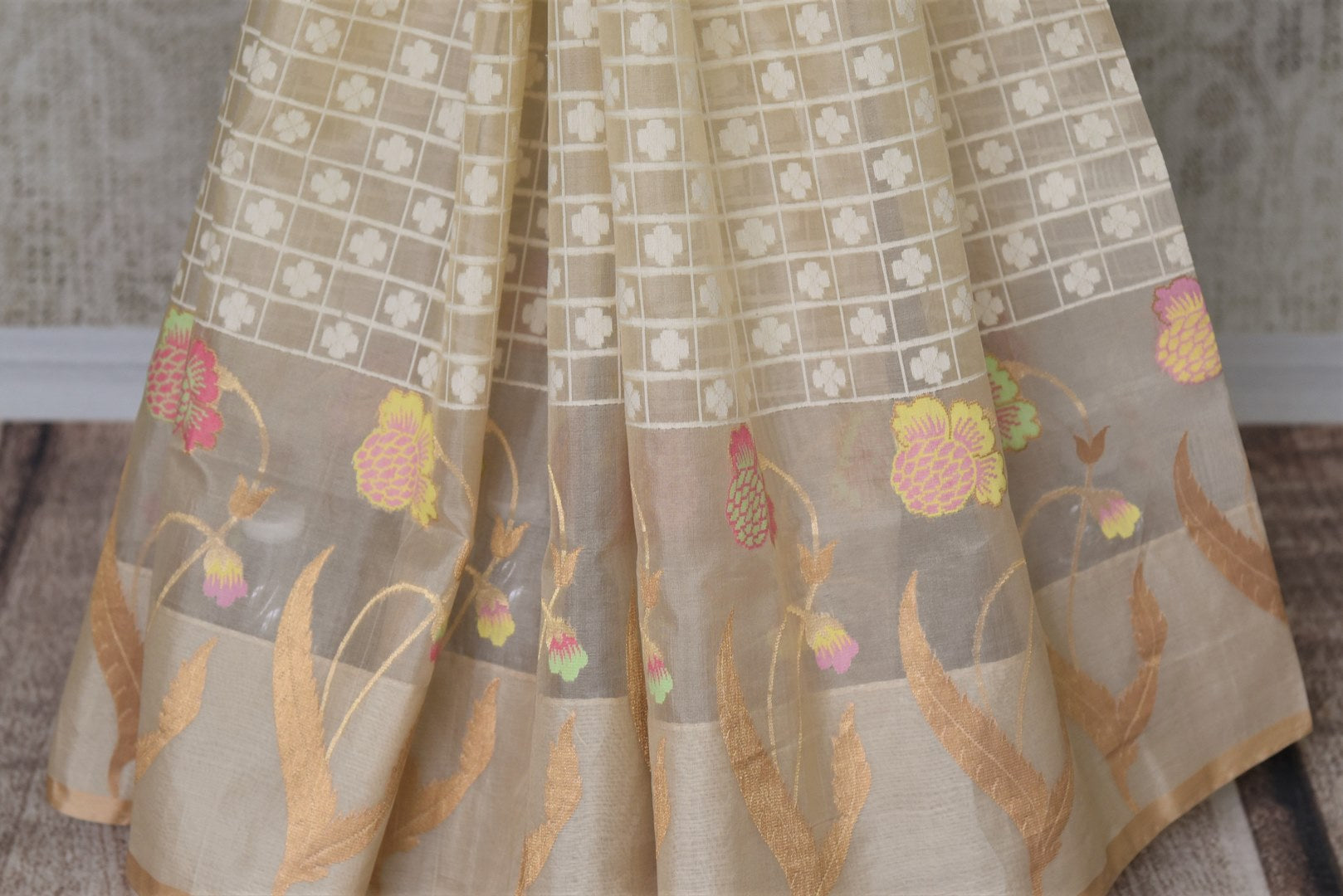 Buy cream organza Banarasi saree online in USA with check design. Give your Indian look an extra style edge with beautiful Indian designer sarees available at Pure Elegance Indian clothing store in USA or shop online.-pleats