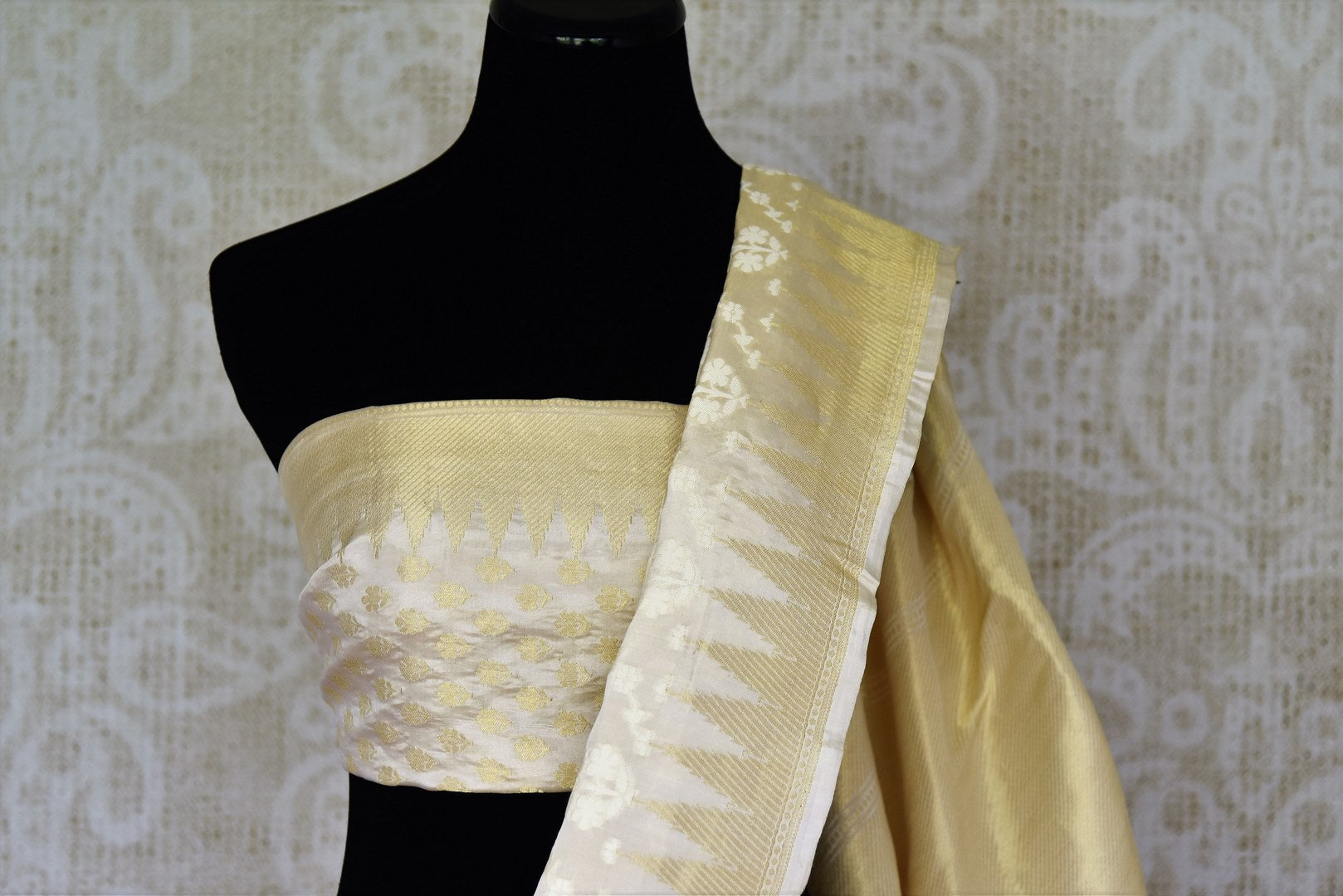 Off-white Benarasi silk saree with temple zari border buy online in USA and floral design. Adorn your style with a range of exquisite handloom sarees from Pure Elegance Indian clothing store in USA. We have an exquisite range of Indian designer sarees, silk sarees, Banarasi saris and many other varieties also available at our online store.-blouse pallu