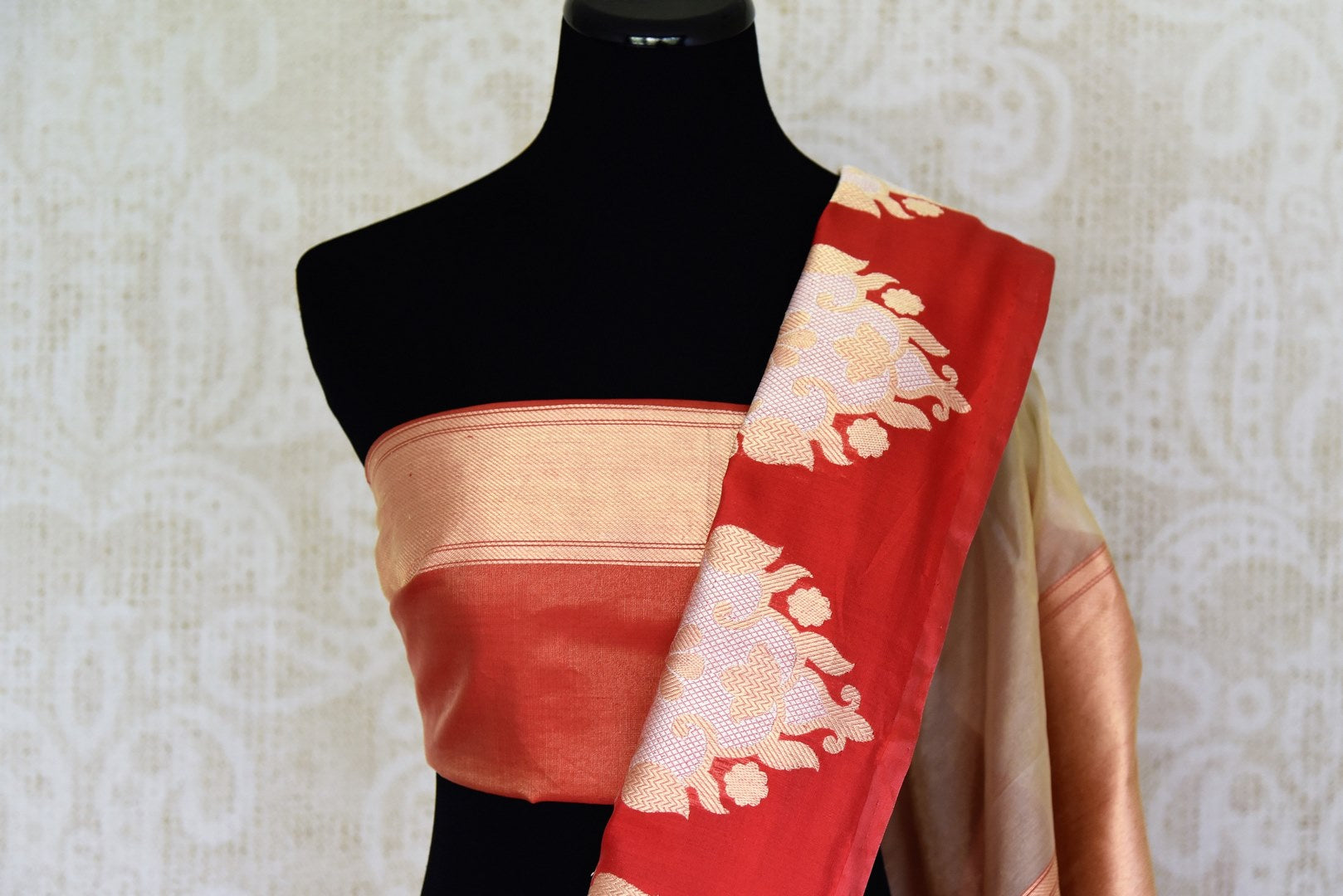 Buy white Banarasi silk saree online in USA with red border with big zari buta. Find an exquisite range of Banarasi sarees in USA at Pure Elegance Indian clothing store. Enhance your ethnic look with a variety of silk sarees, Kanchipuram sarees, and Indian jewelry available at our online store.-blouse pallu