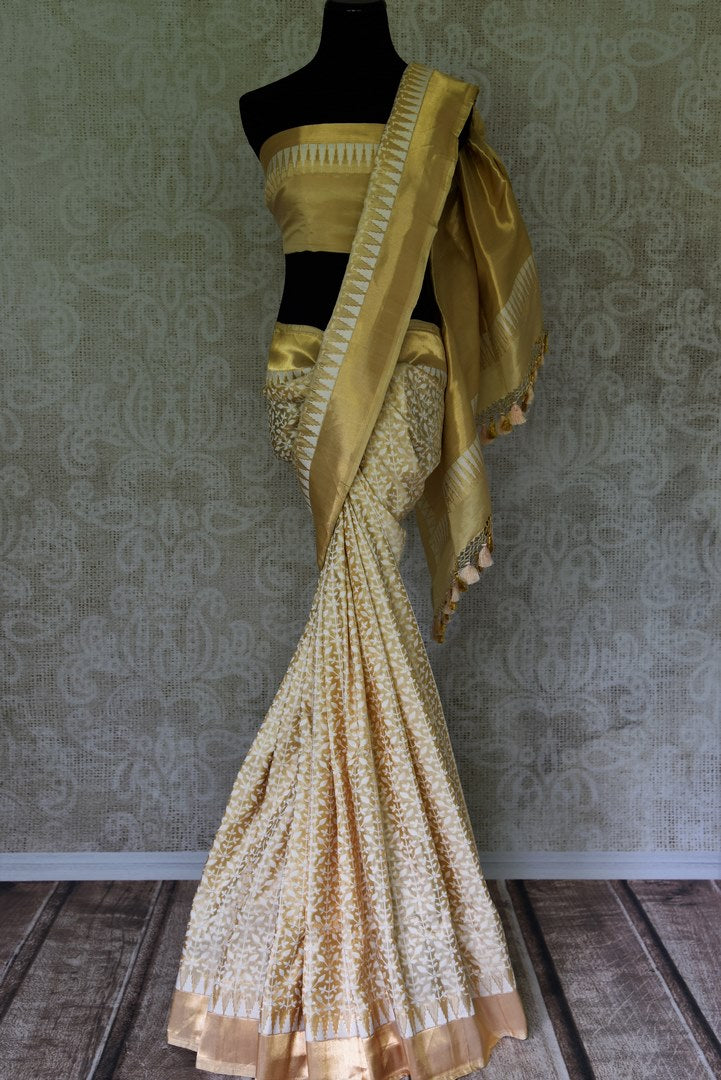 Captivating gold Benarasi silk saree with zari border buy online in USA and white floral design. Adorn your style with a range of exquisite handloom sarees from Pure Elegance Indian clothing store in USA. We have an exquisite range of Indian designer sarees, silk sarees, Banarasi saris and many other varieties also available at our online store.-full view