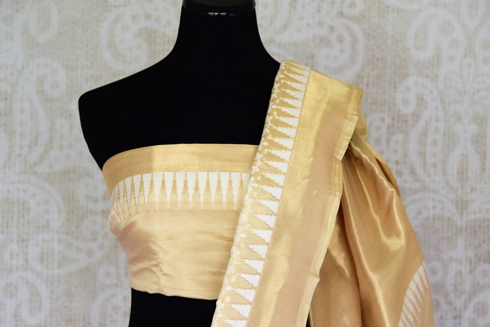 Captivating gold Benarasi silk saree with zari border buy online in USA and white floral design. Adorn your style with a range of exquisite handloom sarees from Pure Elegance Indian clothing store in USA. We have an exquisite range of Indian designer sarees, silk sarees, Banarasi saris and many other varieties also available at our online store.-blouse pallu