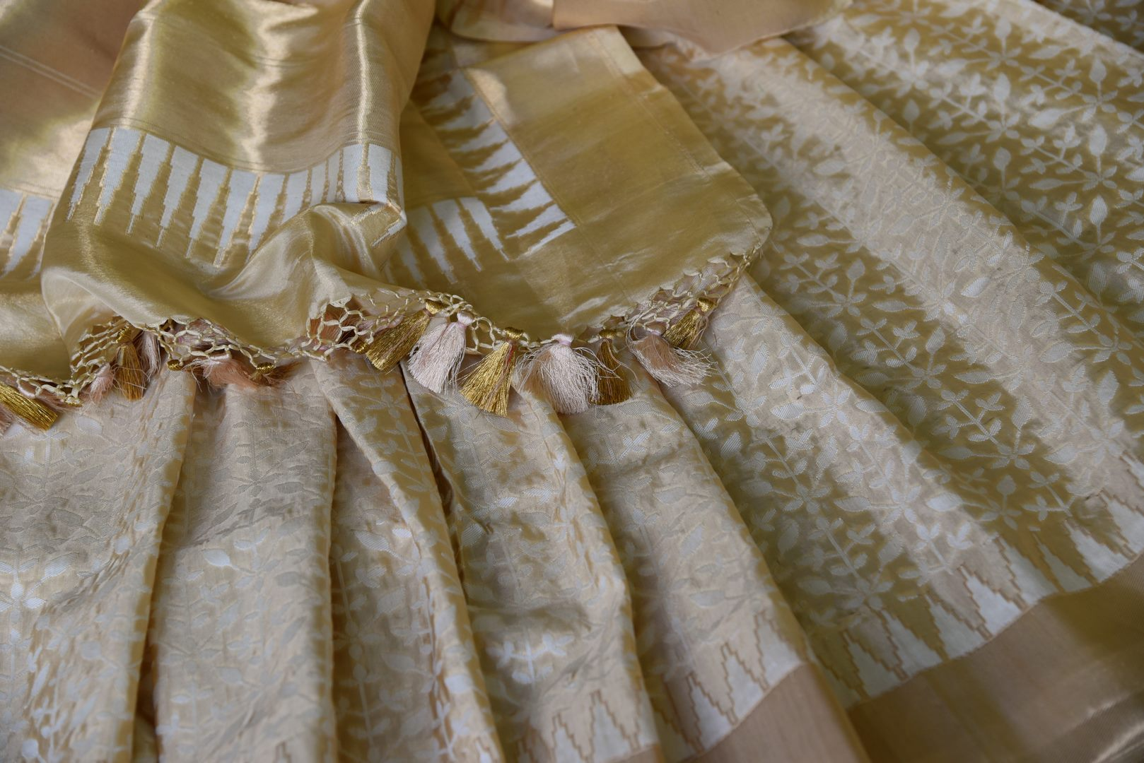 Captivating gold Benarasi silk saree with zari border buy online in USA and white floral design. Adorn your style with a range of exquisite handloom sarees from Pure Elegance Indian clothing store in USA. We have an exquisite range of Indian designer sarees, silk sarees, Banarasi saris and many other varieties also available at our online store.-details