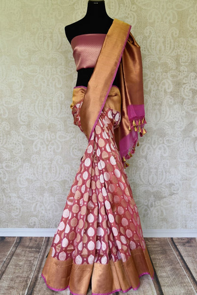 Flaunt your gorgeous self in this pink authentic banarsi silk saree. It comes with a beautiful dull gold border to exude the elegance of this sophisticated sari. Style it with a plain silk pink blouse and shop handcrafted silk sarees, designer linen saris, banarsi silk saree online or visit Pure Elegance store, USA. -full view