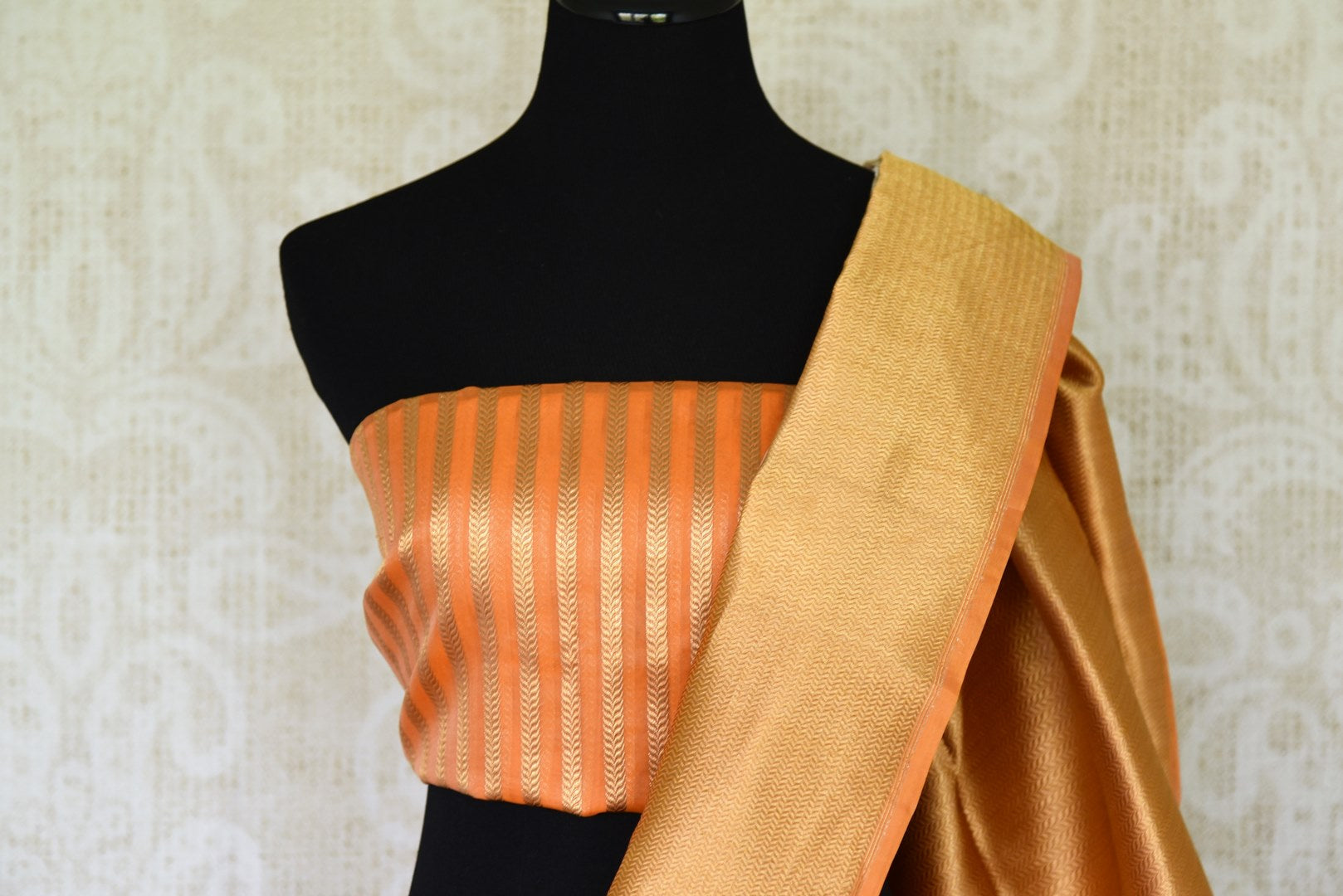 Leave them breathless as you step the aisle in this rich authentic white banarsi silk weave saree with a stunning gold zari border. The beautiful buta work adorned all-over the saree complemented with a contrasting gold woven blouse. Shop designer silk saree, ikkat sari online or visit Pure Elegance store, USA. -blouse pallu