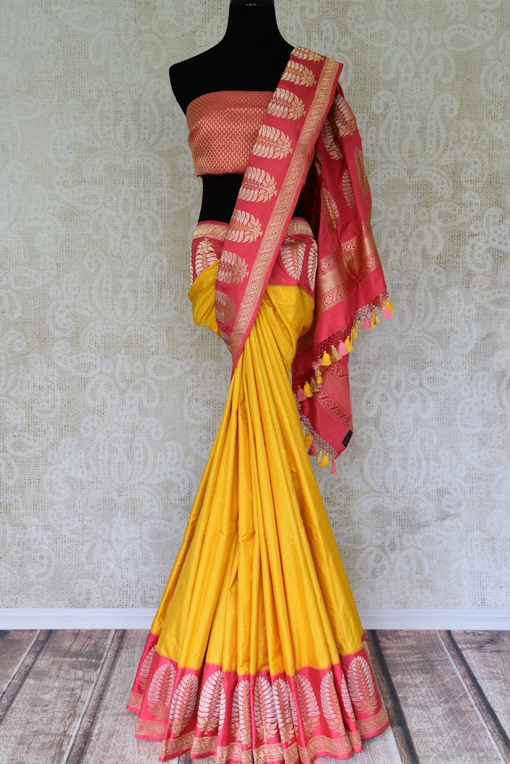 Buy yellow Benarasi silk saree online in USA with pink border with zari buta. Find an exquisite range of Banarasi sarees in USA at Pure Elegance Indian clothing store. Enhance your ethnic look with a variety of silk saris, Kanchipuram sarees, and Indian jewelry available at our online store.-full view