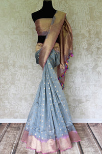Channel sophistication in this grey kora banarsi silk sari. It comes with beautiful gold buta work and gold zari designer border. Style this saree with a scintillating zari gold blouse to catch the fancy of people. Shop handcrafted silk sarees, designer sari, kalamkari saree online or visit Pure Elegance store, USA. -full view