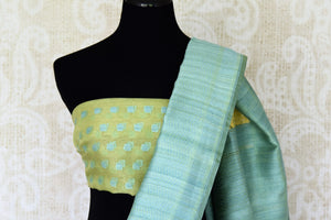 Serenade in solace in our yellow kora banarsi silk saree. The rustic blue border graces the wonderful facade of this silk sari, Style this stunning sari with a contrasting mint blue blouse with buta work. Shop handloom sarees, linen sari, chiffon sarees online or visit Pure Elegance store, USA.-blouse pallu