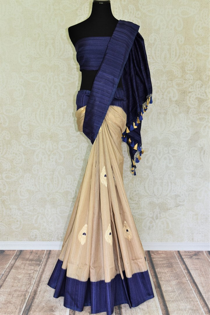Buy cream Banarasi silk saree online in USA with blue border and zari buta. Give your Indian look an extra style edge with beautiful Indian designer saris available at Pure Elegance Indian clothing store in USA or shop online.-full view